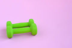 Dumbbells on pink background Royalty Free Stock Photos