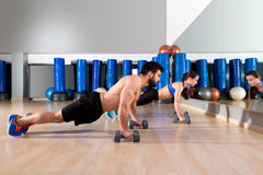 Dumbbells push-ups couple at fitness gym Royalty Free Stock Photo