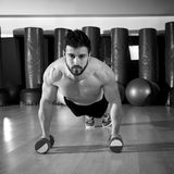 Dumbbells push-ups man at fitness gym Royalty Free Stock Photography
