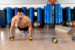 Dumbbells push-ups man at fitness gym Royalty Free Stock Photos