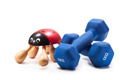 Dumbbells. In a rubberized shell and massager on a white background Stock Photography