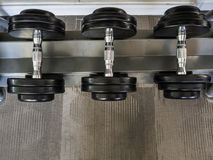 Dumbbell set left on the racks. royalty free stock photography