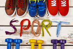 Dumbbells, shoelaces and sport shoes. Love for active life Stock Photos
