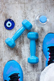 Dumbbells and sport shoes Royalty Free Stock Image