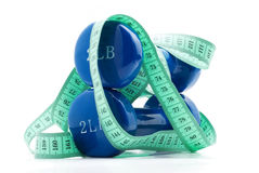 Dumbbells and tape measure Royalty Free Stock Image