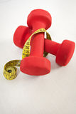 Dumbbells and tape measure Royalty Free Stock Photos