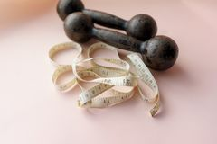 Dumbbells and Tape Measure, Fitness Concept Royalty Free Stock Photography