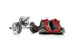 Dumbbells and tennis shoes Stock Images