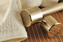 Dumbbells and terry towel on bamboo mat Stock Photo