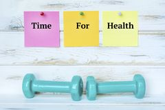 Dumbbells and Time for Health Notes. Green dumbbells and Sticky Notes . Fitness Concept with Motivational Quote stock images