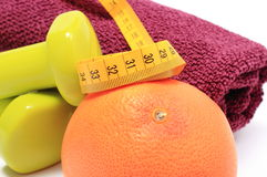 Dumbbells and towel for using in fitness, fresh fruit with tape measure Stock Image