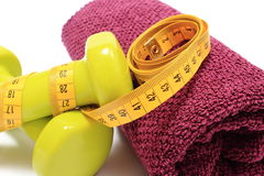 Dumbbells and towel for using in fitness and measure tape Stock Images