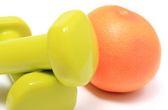Dumbbells for using in fitness and fresh fruit Stock Images