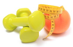 Dumbbells for using in fitness, fresh fruit and tape measure Stock Photos