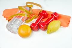 Dumbbells, water and fruits Royalty Free Stock Images