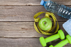 Dumbbells, water and tape measure Stock Photo