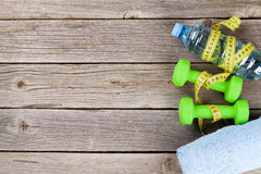 Dumbbells, water and tape measure Royalty Free Stock Photo