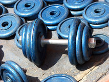 Dumbbells Weight. Dumbbells and weights with other gym equipment for sale in an Indian streetside shop Royalty Free Stock Images