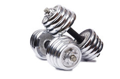 Dumbbells  on the white background Stock Photography