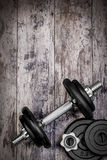 Dumbbells on the wood Stock Image