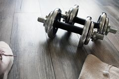 Dumbbells on a wooden floor royalty free stock images
