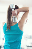Dumbbells workout rear view Royalty Free Stock Images