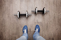 Dumbbells and you. Unique perspective: a look at the dumbbell like own eyes Stock Photos