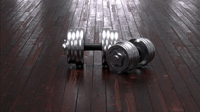 Dumbbels on wooden floor Royalty Free Stock Image