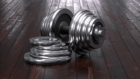 Dumbbels on wooden floor Royalty Free Stock Photos