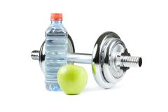 Dumbell, bottle and green apple. Metal dumbell with green apple and bottle of water. Isolated on white Stock Image