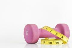 Dumbell e fita de medição Fotografia de Stock Royalty Free