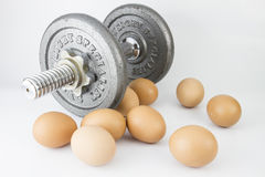Dumbell and egg more protein Royalty Free Stock Photo
