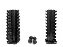 Dumbell Rack. A dumbell rack with dumbells isolated against a white background Stock Photo