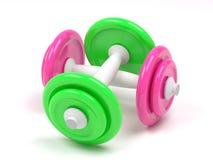Dumbell rosado y verde Imágenes de archivo libres de regalías