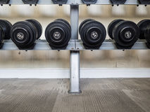 Dumbell set left on the racks. royalty free stock photos