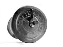 Dumbell weight 2. Isolated on white grayscale photo of a dumbell weight used for exercising one arm at a time stock images
