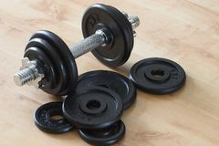 Dumbell & weights. Dumbell & loose weights royalty free stock photos