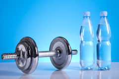 Dumbells. And bottles of mineral water Stock Photography