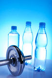 Dumbells. And bottles of mineral water Stock Photo