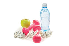 Dumbells, apple and measuring tape Royalty Free Stock Photos