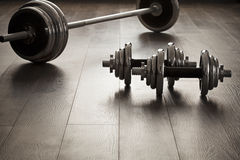 Dumbells for fitness on wooden floor. With empty space Stock Photos