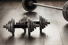 Dumbells for fitness on wooden floor Royalty Free Stock Photo