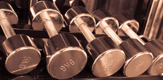 Dumbells in gym  vintage tone Royalty Free Stock Photography