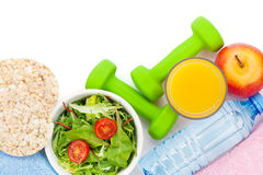 Dumbells, healthy food and towels. Fitness and health. Isolated Stock Photo
