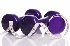 Dumbells and measure tape Royalty Free Stock Photos