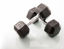 Dumbells over white background and with reflections Royalty Free Stock Image