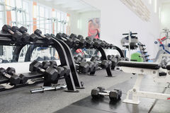 Dumbells. In a rack at the gym Royalty Free Stock Image