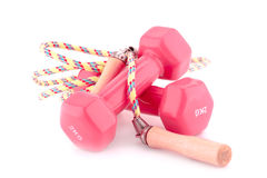 Dumbells and skipping rope Royalty Free Stock Images