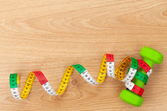 Dumbells and tape measure. Fitness and health Stock Photo