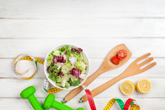 Dumbells, tape measure and healthy food Stock Photography